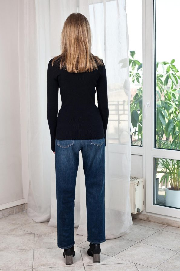 Black knit ribbed roll neck jumper from the back
