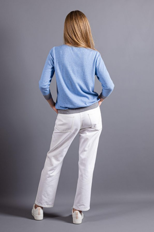 Cashmere alpaca wool blend womens sweater in light blue with with grey sequined cuffs, bottom hem, and inside part of the pocket